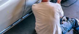 mechanic fixing broke down car
